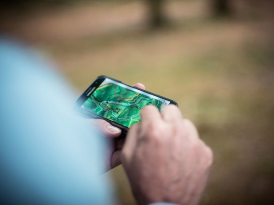 Person using a map on a smartphone
